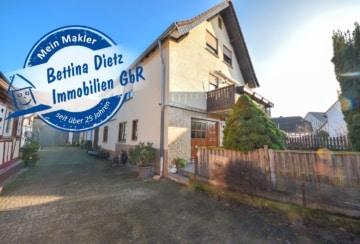 DIETZ: Provisionsfreie Erdgeschosswohnung mit eigenem Garten, großer Garage und Kellerraum in Harpertshausen!, 64832 Babenhausen, Terrassenwohnung