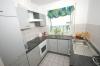 Für jung und alt 2 Zimmer Erdgeschoss-Terrassen-Wohnung,  - zentrumsnah - mit Garten! - Einblick Küche