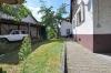**VERMIETET** DIETZ: 1. Monat mietfrei! Gemütliches Einfamilienhaus für die kleine Familie! Car-Port + Einbauküche INKLUSIVE! - Teilansicht des Gartens
