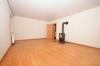 **VERMIETET**DIETZ: Gemütliche 2-Zimmerwohnung mit EBK und West-Balkon im Ortsteil von Groß-Umstadt! - Wohnzimmer mit Holzofen1