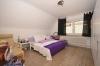DIETZ: TOP 3 Zimmerwohnung mit Balkon - PKW-Stellplatz - optionaler Einbauküche in guter Lage von Nieder-Roden - Schlafzimmer 1 von 2