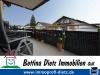 DIETZ: 2 Zimmer Erdgeschosswohnung mit extrabreiter Garage, Terrasse, Fußbodenheizung - Solarenergie - Freisitz