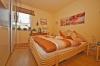 DIETZ: 2 Zimmer Erdgeschosswohnung mit extrabreiter Garage, Terrasse, Fußbodenheizung - Solarenergie - Schlafzimmer 1 von 1