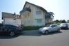 DIETZ: 2 Zimmer Erdgeschosswohnung mit extrabreiter Garage, Terrasse, Fußbodenheizung - Solarenergie - Außenansicht Mehrfamilienhaus