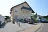 DIETZ: 2 Zimmer Erdgeschosswohnung mit extrabreiter Garage, Terrasse, Fußbodenheizung - Solarenergie - Einfahrt Tiefgarage