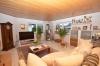 **VERMIETET**DIETZ: 4-Zimmer-Terrassenwohnung mit eigenem Garten, Doppelgarage und Einbauküche - Wohnbereich mit Holzofen