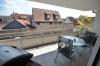 DIETZ: Neuwertige 3-Zimmer-Wohnung mit Aufzug, Einbauküche, Fußbodenheizung und Balkon! - Überdachter Balkon