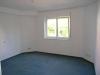*Verkauft* Helle  2 Zimmer Gartenwohnung in gepfl. kleiner Wohneinheit mit Garagenstellplatz..  (EG - Ein Blick ins Schlafzimmer
