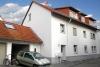 **Verkauft**   Modernes 3 Familienhaus mit 3 Wohnungen und einem Appartement - Ansicht mit Garagen (TOP IN SCHUSS)