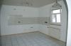 **Verkauft**   Modernes 3 Familienhaus mit 3 Wohnungen und einem Appartement - Eine der Küchen