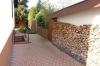 **VERKAUFT**  1-2 Familienhaus mit Traumgarten und Garage. In ruhiger Lage - Holzlager für den Kamin