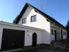 *Verkauft** Luxuriöses Einfamilienhaus mit Traumgrundstück - Hausansicht mit Garage