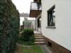 **VERKAUFT** 1996 modernisiertes  2 Familienhaus mit 3 Garagen und Garten. **Komplett frei und super günstig** - Terrassenaufgang