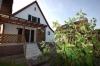 **VERKAUFT**  Einfamilienhaus mit Nebengebäude und Garten. - Hintere Hausansicht