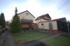 **VERKAUFT**DIETZ: Modernisiertes 1-2 Familienhaus mit Wintergarten, großem Garten und Doppelgarage! - Hintere Hausansicht