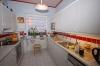 **VERKAUFT**DIETZ:  Bungalow mit kleiner Einliegerwohnung im Souterrain - Moderne Einbauküche inklusive