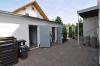 **VERKAUFT** DIETZ: Modernisiertes 2 Familienhaus auf pflegeleichtem Grundstück! Ruhig UND zentrumsnah! - Blick Richtung Garage